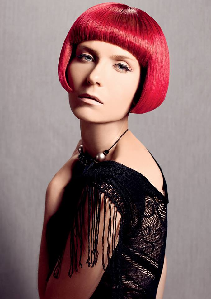 Pixie looking hairstyle for red haired women with short-cut bangs