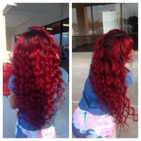 Long, curly, red hairstyle