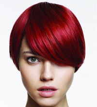 Pixie hairstyle for red haired with longer bangs