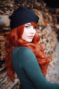 Long, curly, red hairstyle with a beanie