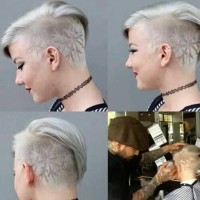 Great short, platinum hairstyle with shaved pattern in a form of a snowflake