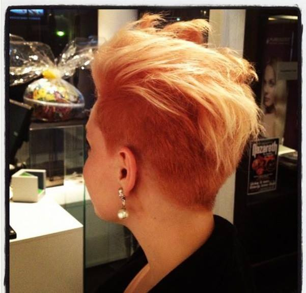 Short blonde hair with mohawk and orange trimmed sides