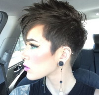 Short, classic, pixie haircut for brown hair