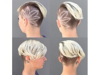 Amazing short, blon hairstyle with darker sides and a leaf shaved pattern