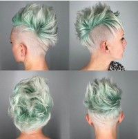 Short, platinum hairstyle with green mohawk