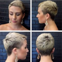 Short, blond hairstyle with darker trimmered sides and short fringe