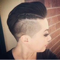 Short, dark haircut with high fade and textured fringe