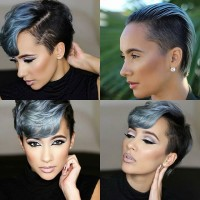 Short, dark hairstyle with longer fringe and blue highlights