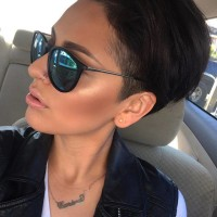 Short, dark haircut for pixie lovers