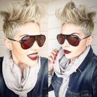Wild, short, blond haircut with mohawk and shaved sides