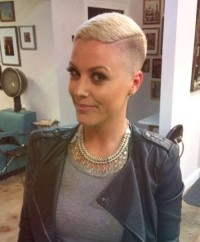 Extra short hairstyle in pixie's style with edgy undercut