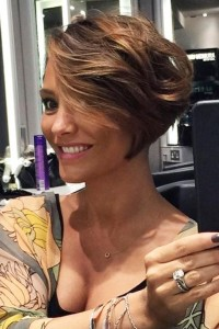 Short, pixie looking hairstyle with weavy, side-swept fringe
