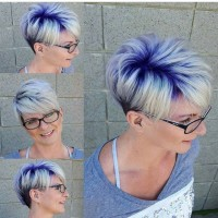 Short, messy looking, pixie hairstyle with blue highlights