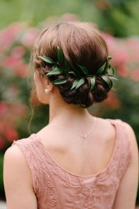Long, brown, boho hairstyle with braid and plant-based ornament