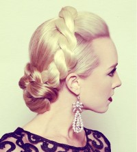 Classic updo with thick braid and swept back fringe