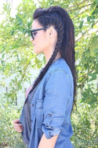 Long, dark hair with sided man's braid