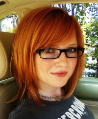Medium-length, choppy hairstyle for red haired girls in glasses