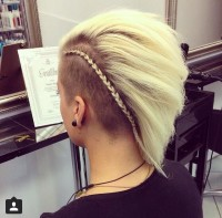 Short, pixie hairstyle with mohawk and thick sided braid