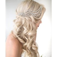 Long, light blonde hair with curls and pearl headband