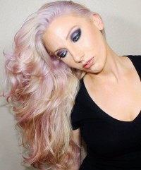 Subtle, long hairstyle with wavy streaks and violet reflections
