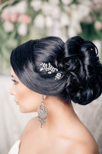 Long, dark hair updo with a bun for wedding