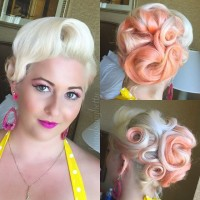 Short, pin-up hairstyle with orange highlights and tied wavy streaks