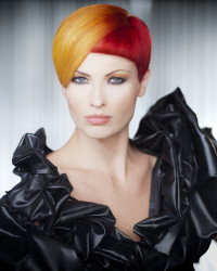 Short, pixie, layered haircut with orange and red hair