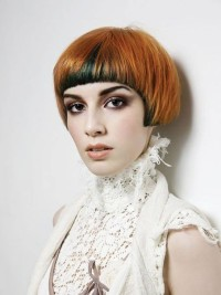 Short, bowl cut hairstyle with regular bangs and red hair