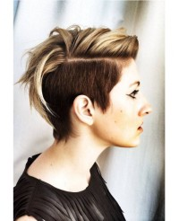 Short, pixie, trimmed hairstyle with light blonde highlights and side-swept fringe
