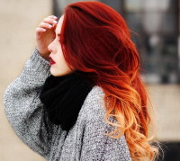 Long, curly, red hairstyle with blonde endings