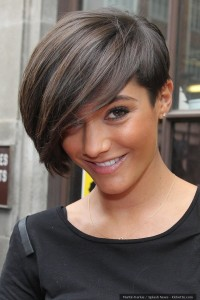 Short, pixie hairstyle with heavy side-swept fringe