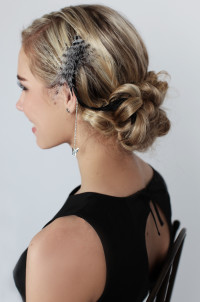Elegant updo with feathers
