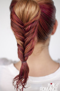 A blonde braid with red highlights
