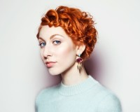 Short, pixie hairstyle for red haired girls with curls