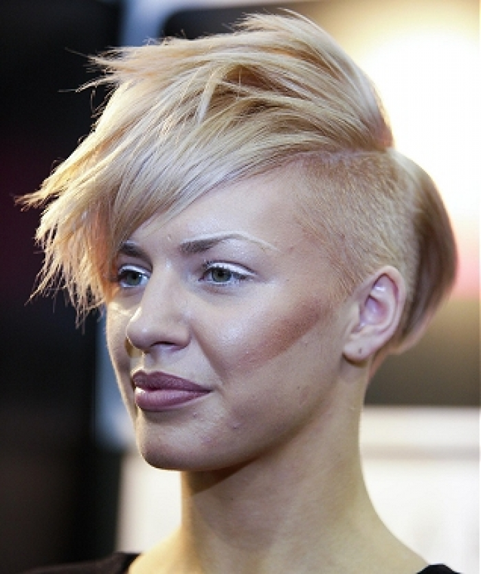 Short Pixie Hairstyle With Shaved Side And Messy Looking Fringe