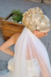 Wedding updo with fancy curled locks of hair