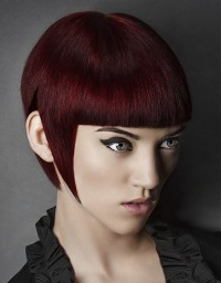 Short, dark red haircut with regular bangs