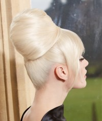 An updo with high bun and longer front streaks