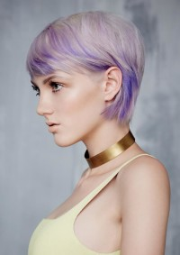 Short, classic, pixie haircut with violet highlights