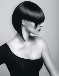 Short, bowl cut hairstyle for dark hair