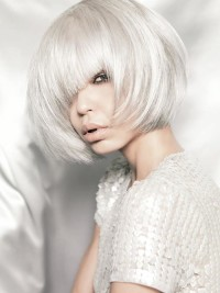 Medium-length platinum hair with blunt bangs