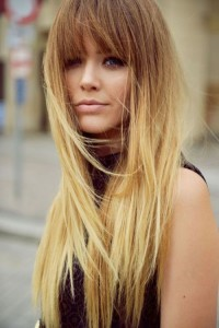 Long, blonde hairstyle with blunt bangs