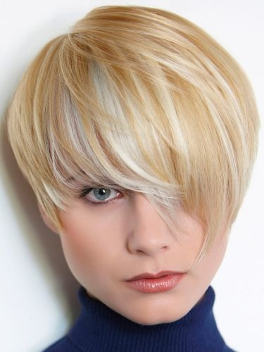 Short, pixie, blond hairstyle with platinum highlights