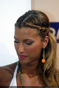 An updo with pony tail and braid