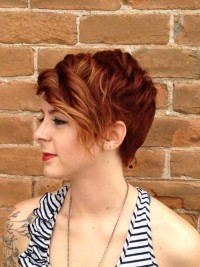 Short, pixie, dark blonde hairstyle with curly fringe