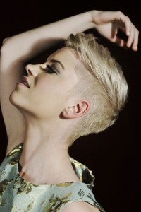 Short, blonde hairstylr with shaved sides