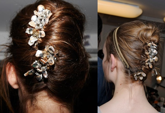 Amazing updo for brown haired girls with flower decorations