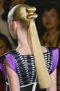 Updo with long, stylized pony tail for blonde hair