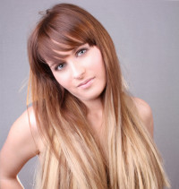 Long, blonde hairstyle with blunt bangs and ombre effect