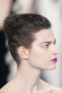 Short, black hairstyle with swept back fringe